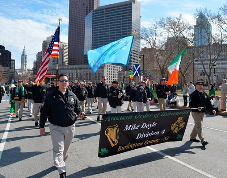 Irish Pride – Ancient Order of the Hibernians Division 4 president, Bill Brennan, left, and vice-president, Bobby Tippin, right, carry the AOH banner in the Philadelphia St. Patrick's Day parade March 10. Some 40 members of the Burlington division of this Catholic fraternal organization joined in the march.   Eileen Fuzer photo