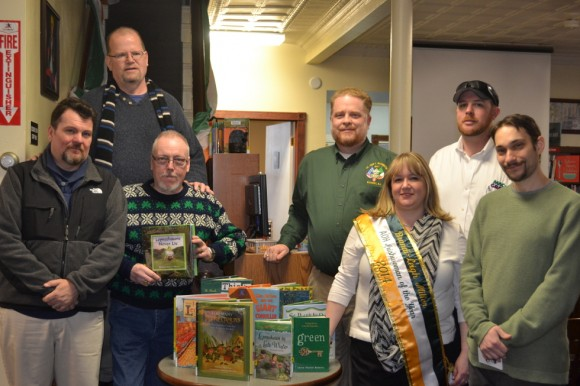 Pictured L to R; Tony McGovern, Ken Evans, Garry Egan, Jim Miller, AOH Irishwoman of the Year Brandi-Leigh Miller, Doug McGovern, and Kearny Library Director Josh Humphrey